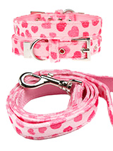 Pink Hearts Fabric Collar & Lead Set - This Pink Hearts collar and lead set is a perfect girly accessory. It is a contemporary style and the pattern is on trend. It is lightweight and incredibly strong. The collar has been finished with chrome detailing including the eyelets and tip of the collar. A matching lead, harness and bandana are...